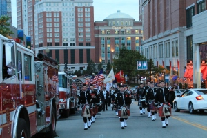 Local Fire Departments join to provide pipe and drum escorts to burn survivors, family members and other attendees of WBC 2013