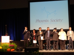 "A stirring rendition of ""The Star Spangled Banner"" opens the Phoenix Society's 25th Annual World Burn Congress"